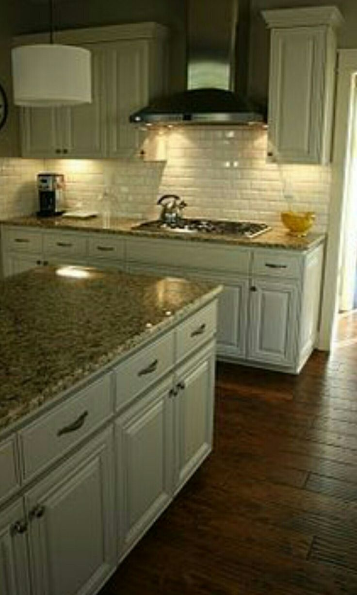 Beige Granite Countertops With White Cabinets And Subway