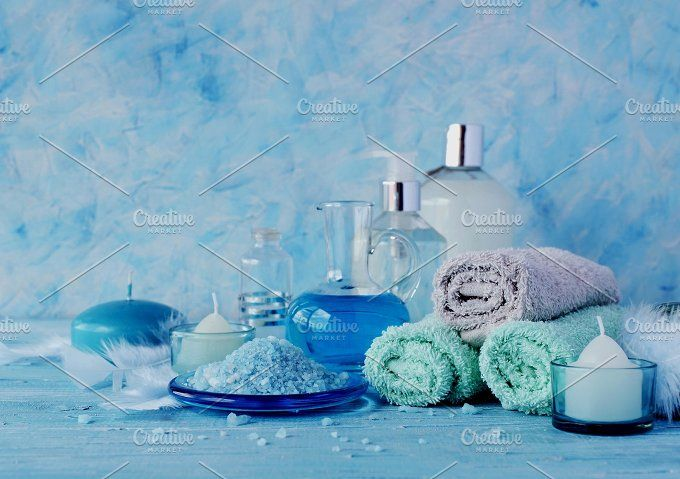Set for spa with towels, salt and aromatic oils, selective focus by Wild Drago Shop on @creativemarket