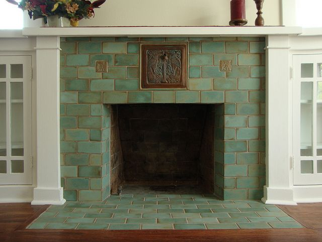 Celadon Fireplace - A couple of Batchelder Revival tiles set against high-fired field tiles make a clean fresh fireplace for a Craftsman home.