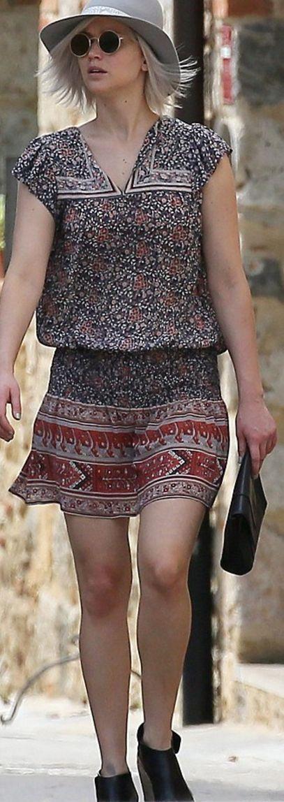 Who made Jennifer Lawrence's print dress, tan hat, black clutch handbag, and sunglasses?