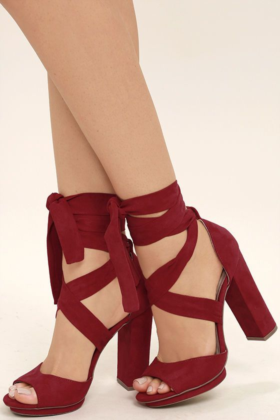 "The Dorian Dark Red Suede Lace-Up Platform Heels are giving us '70s diva vibes! Dance the night away in these vegan suede stunners with a cute peep-toe upper, stepped 0.5"" toe platform, and long laces that wrap around the ankle."
