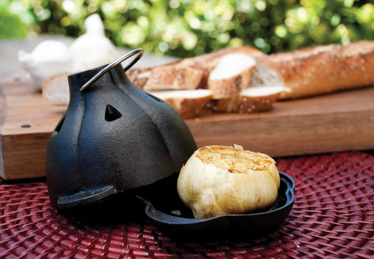 Roasted garlic is nature's original sweet and savory combination. Charcoal Companion's Cast Iron Garlic Roaster mimics the shape of a garlic bulb and holds one large or two medium bulbs of garlic. Includes a handy silicone garlic squeezer, the perfect tool for easily removing roasted garlic from the bulb. This Cast Iron Garlic Roaster will draw out the best flavors of garlic.   HOW TO USE YOUR GARLIC ROASTER: Preheat grill or oven to 400 F. Trim the top of a garlic bulb or two so that the…
