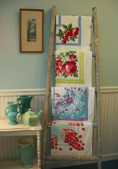 Old ladder to display vintage tablecloth collection. Could be used for bath towels in my master bath.