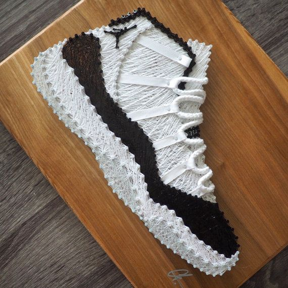 The perfect gift for your favorite Sneakerhead. Using just nails and thread, the Air Jordan 11 Concord is created in the perfect likeness of the actual shoe. Over 300 nails and 400 yards of thread were used to handmake this piece. The Jordan 11 is made on a 11 x 14 Birch plywood board
