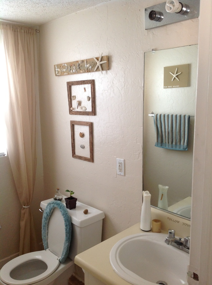 My small rental beach themed bathroom our stoneman for Bathroom beach ideas