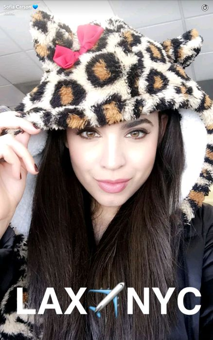 Sofia Carson snapped the prettiest selfie in the airport when flying from Los Angeles to New York City. Her fuzzy animal print hoodie is just too cute!
