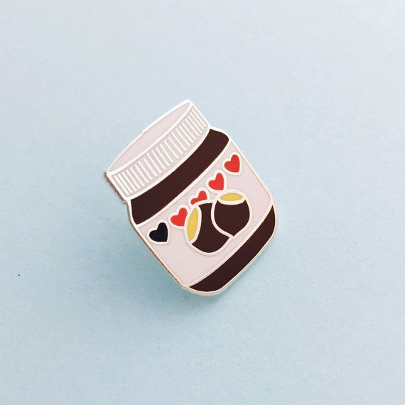 Cute little hard enamel pin badge based on everyones favourite hazelnut and chocolate spread. Yum!  Clutch back. 2cm x 1.6cm.