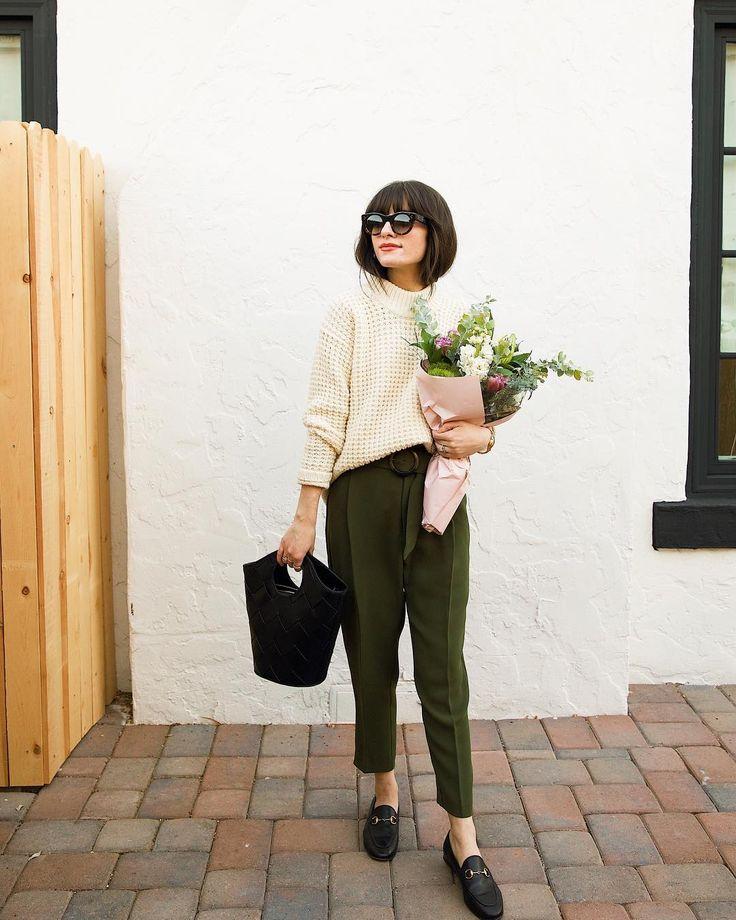 Chunky white sweater and olive slacks