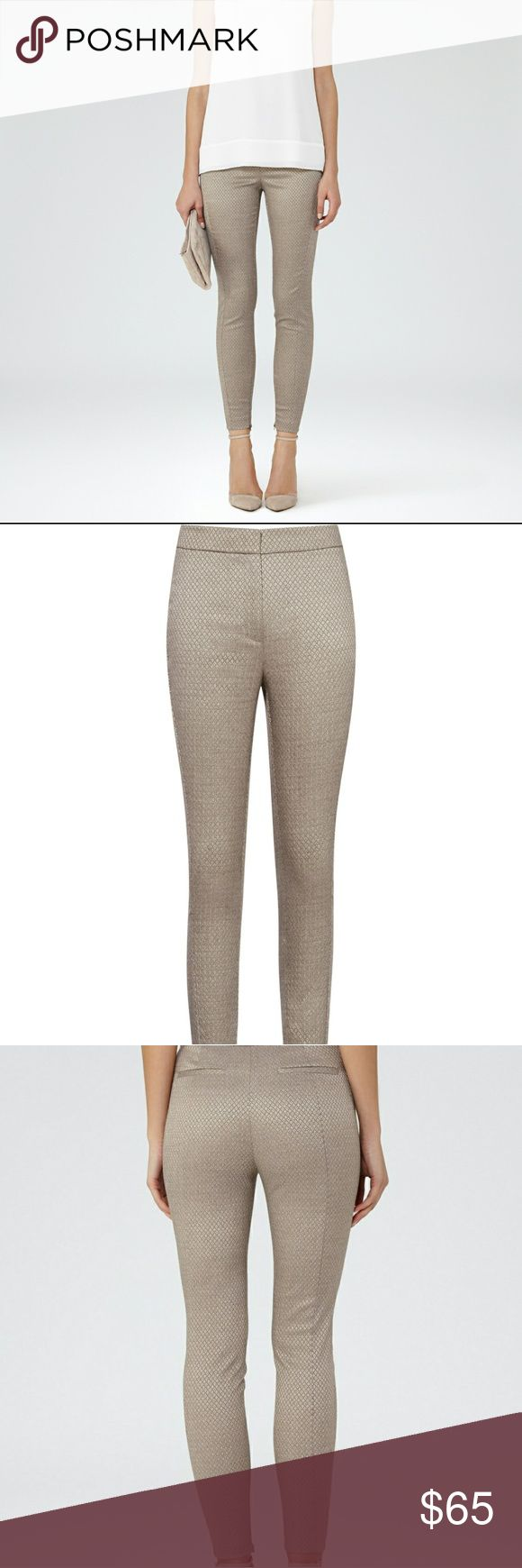 Reiss Jacquard Darleen Skinny Leggings Pants Trousers retail $195   Up the impact of your separates collection with the addition of the pewter-grey Darleen trousers.  Tailored to a slim fit and woven with a contrasting jacquard pattern,  this statement pair works best with a simple black knit or a silk cami.  Mid rise.  Hook and zip fastening.  Wash care: Dry Clean Only.  Composition: 81% Polyester 17% Viscose 2% Elastane.  Color: metallic  sz o  Tags attached are from TJ mass Runway…