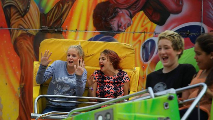 Two young girls having a great time on a ride at Newcastle Show! www.newcastleshow.com.au. March 6-8, 2015.