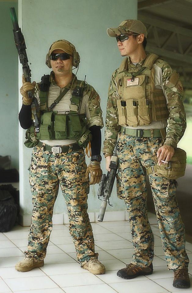 Chris K. & Donny H. at work, training at Djamsuri shooting range, Jakarta, Indonesia. (ICE, Crossbow)