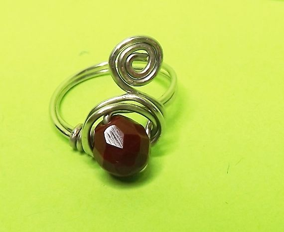 wire weapped ring with red vine colour czech crystal.
