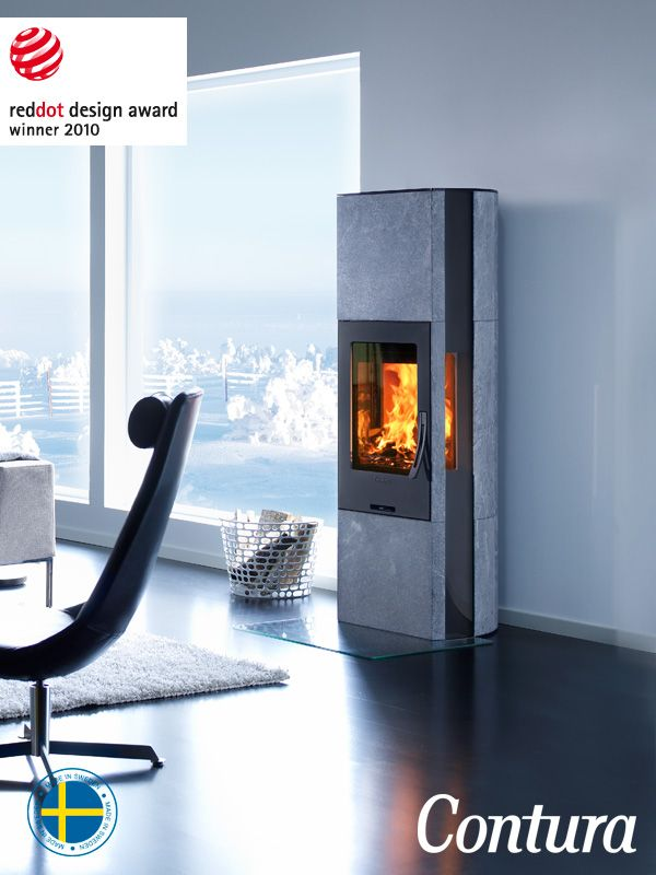 Heat retaining Wood burning stove with soapstone and long glass side panels. Winner of the red dot design Award.
