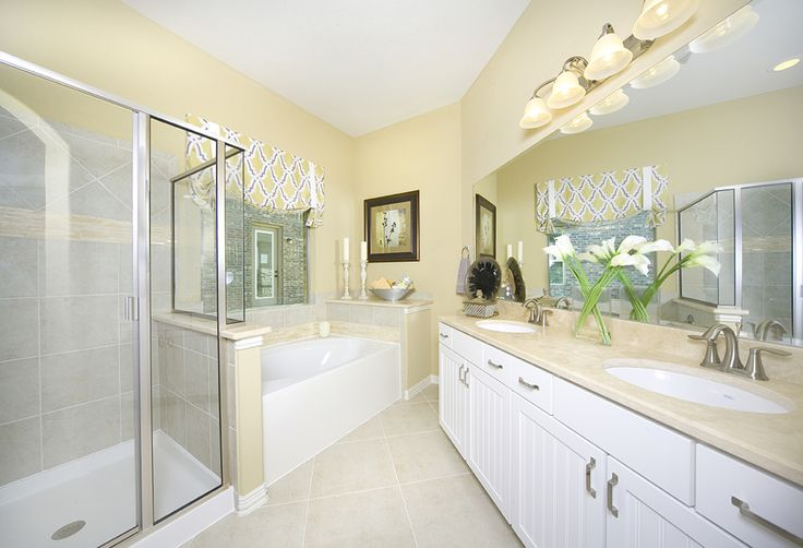 Gehan Homes Master Bathroom Yellow Walls Gray Tile White Cabinets Tan Granite Brushed