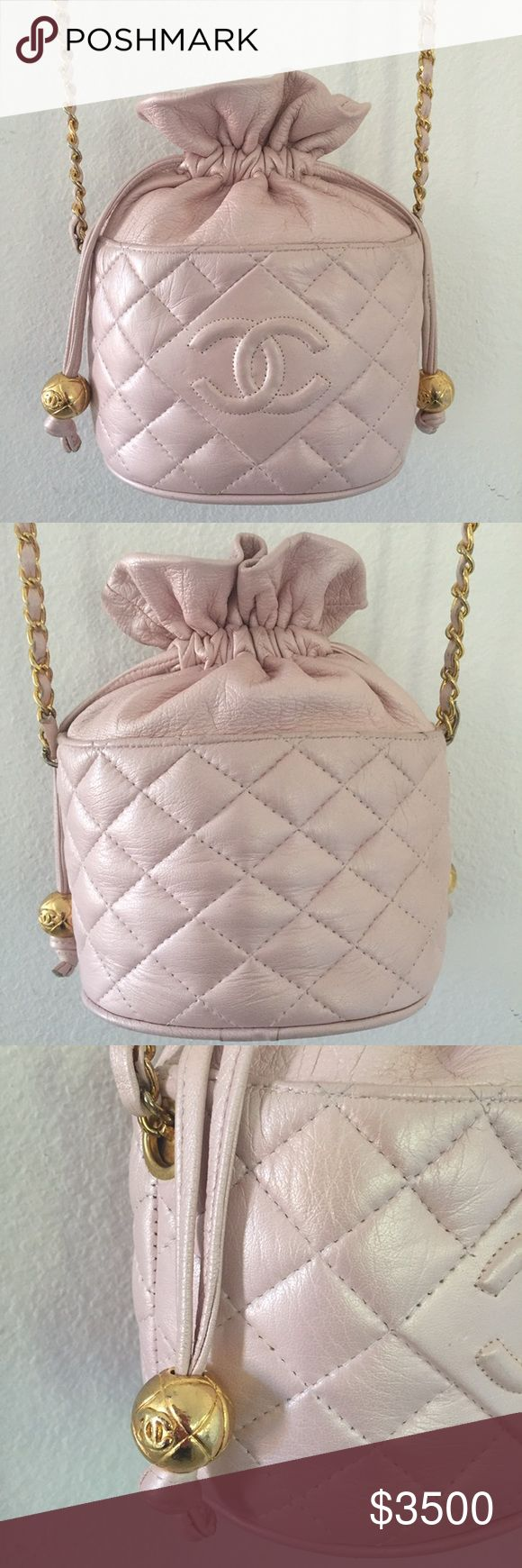 CHANEL PINK QUILTED CC DRAWSTRING BUCKET BAG - Excellent Condition: minor signs of handling on leather/hardware; light wear on chain strap.   - Lambskin leather  - Gold-tone hardware  - Classic Chanel chain shoulder strap - Authentic.  Hologram sticker is gone. - Small amount of what looks like glue residue on inside edge of quilted seam on top back right.  It is not noticeable unless looking for it. CHANEL Bags Shoulder Bags