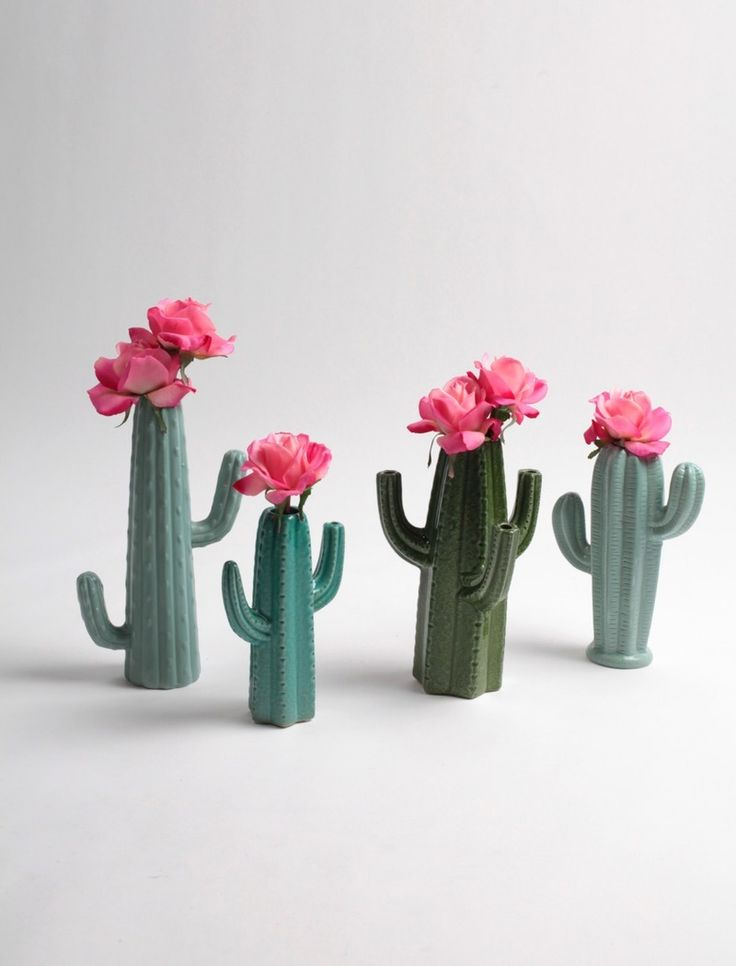 Ditch those basic, clear glass vases for a hot, desert-inspired cacti planter set.