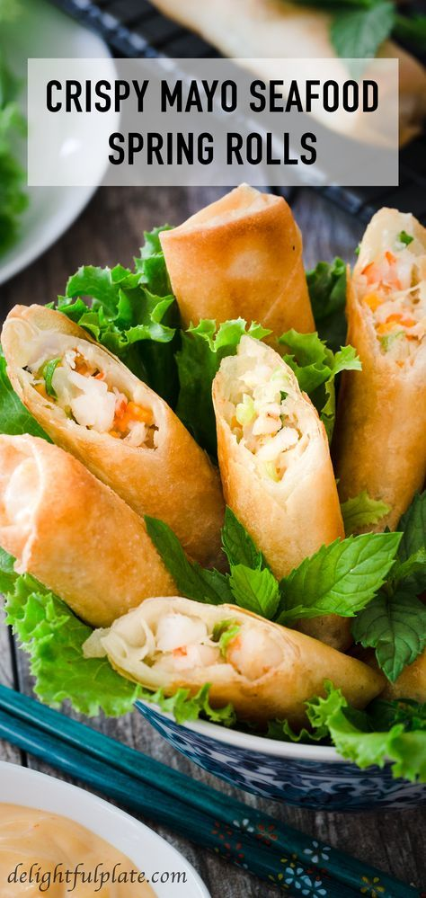 These crispy mayo seafood spring rolls are tasty with piping hot filling which includes crab meat, shrimp, and mayonnaise. Serve them as a quick and fun appetizer with spicy mayo dip, lettuce, and mint.