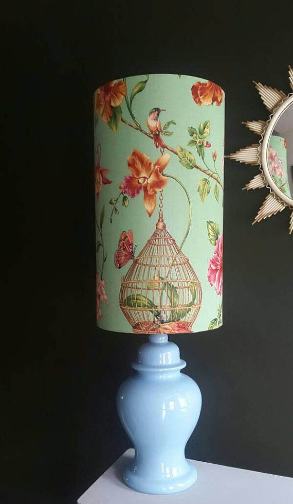 30cm diameter 50cm height large lamp shade with botanical print, featuring birds & flowers. Beautiful gold inner. Suitable for a table lamp or standard lamp. Universal fitting. 1st photo depicts the colour best as is a kind of minty green & on some photos looks blue