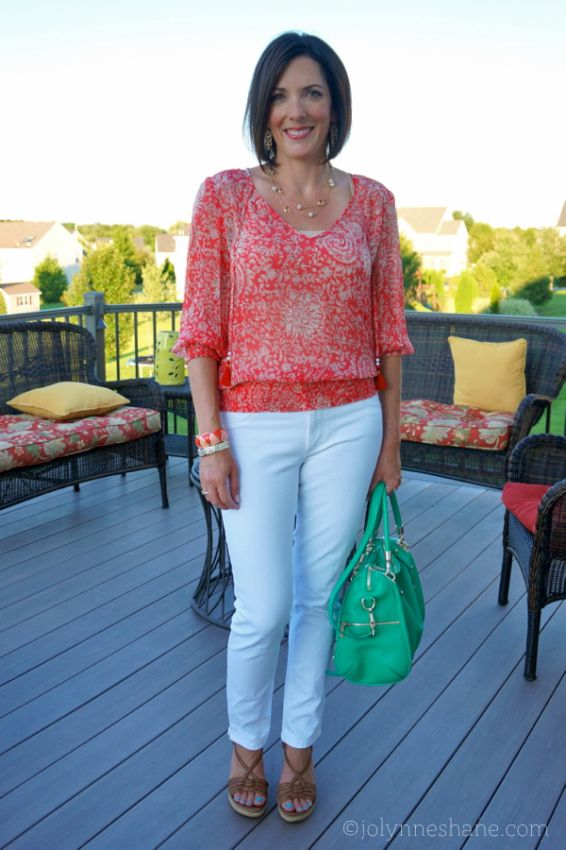 Looks great for summer with light weight fabric and quarter length sleeves. I like that it has a banded waist b/c it doesn't require tucking in jeans. I would wear with blue jeans.