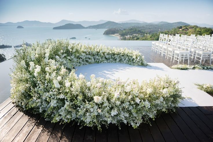 The Bridal Planner Thailand presents a blooming floral wedding altar over the spectacular Andaman sea view See more here: http://www.thebridalplanner.co/