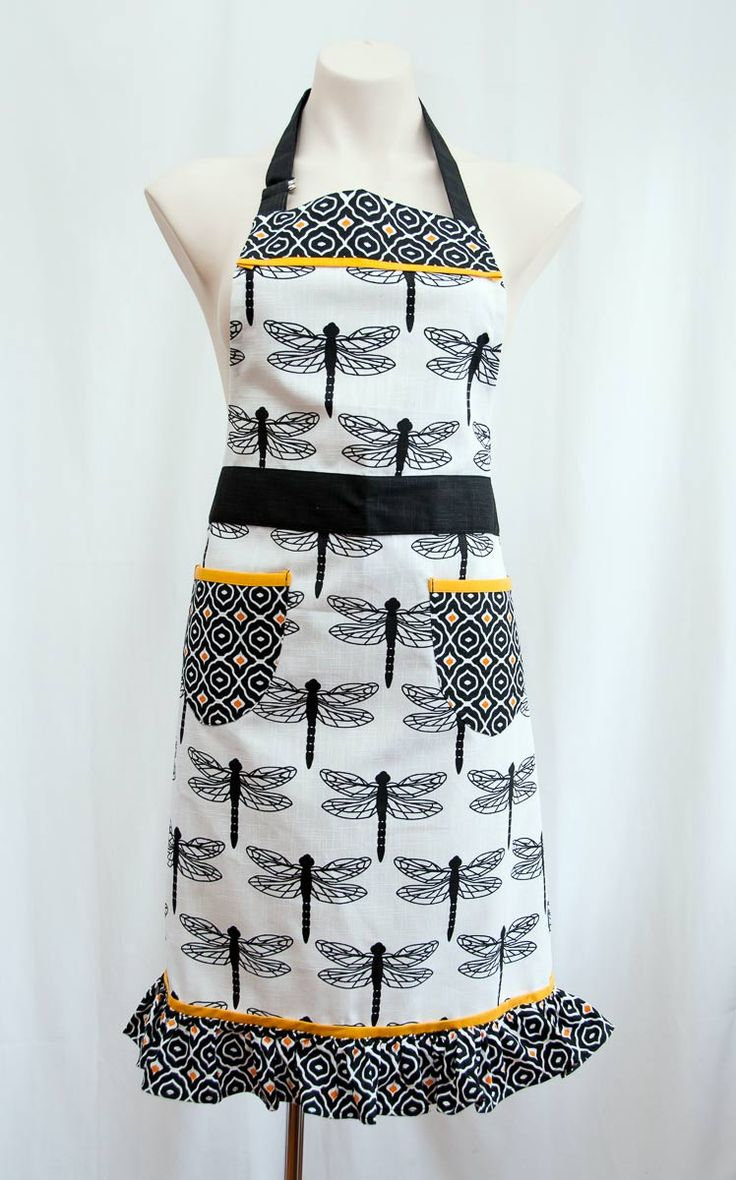 Every time I cook dinner or bake a cake I put on an apron to protect my clothes, so why not wear a gorgeous designer apron! This is a really lovely design in black, white and yellow with awesome dragonflies and a feminine frill around the bottom.  Buy this for yourself or give this as a gift to a friend who loves to cook. This is a unique gift for the women that has everything. The size is approximately 70 x 85cm and this is a high quality cotton fabric. Available from Gorgeous Creatures.