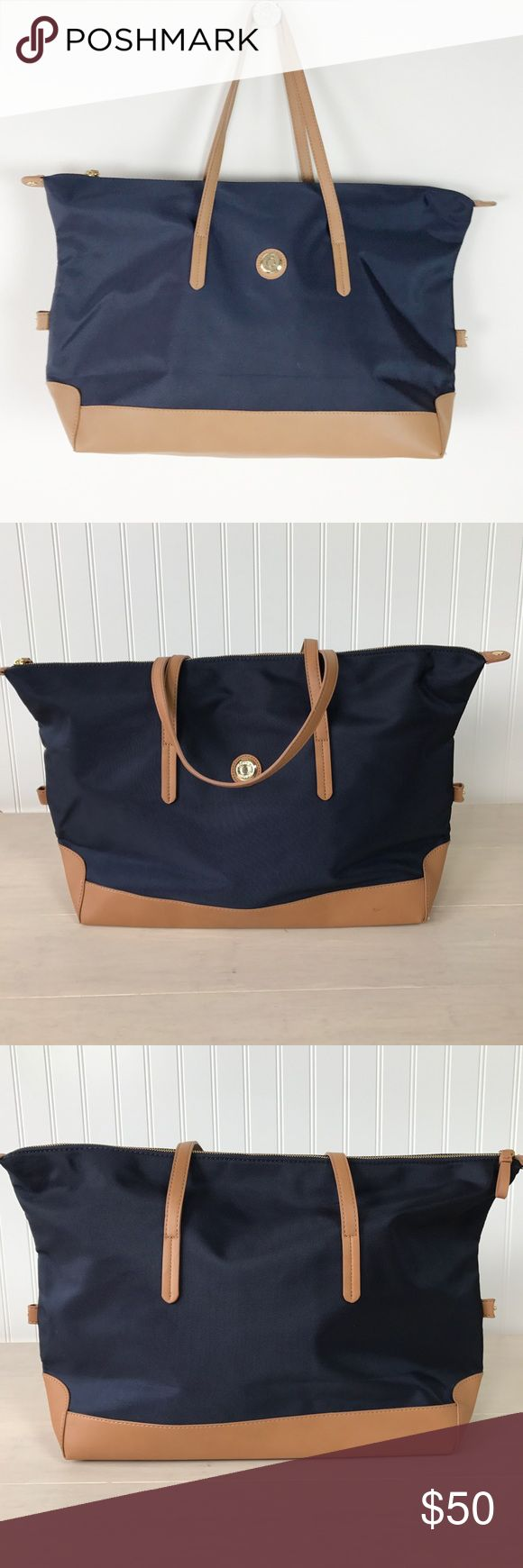 Tommy Hilfiger tote bag! Navy blue with tan trim. Never been carried. Excellent condition. Perfect for weekend travel! Tommy Hilfiger Bags Totes
