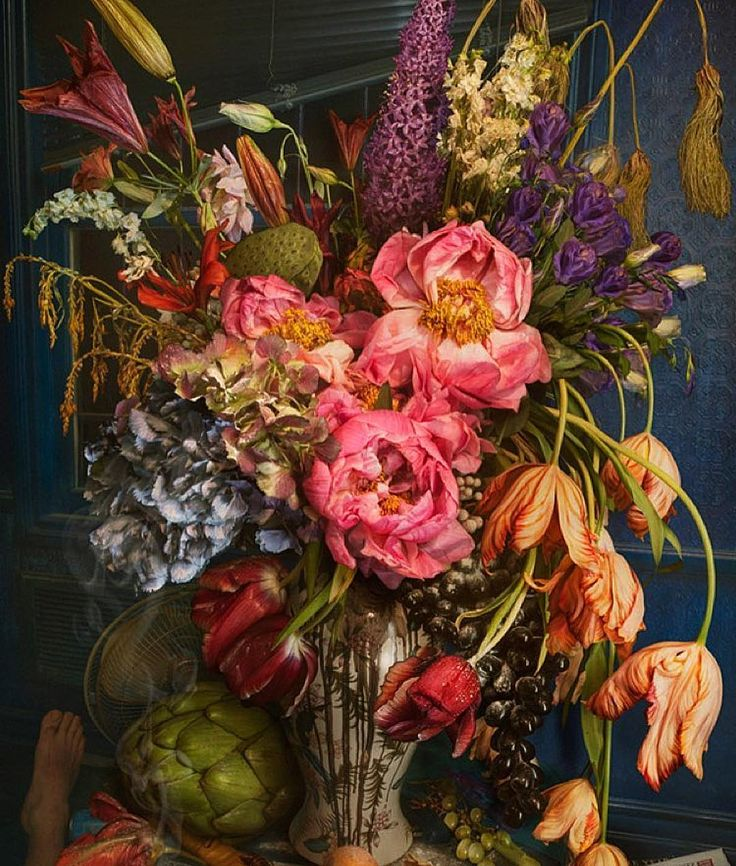 I.  A wonderful arrangement of fully blooming flowers and an artichoke.  Image from @lesherbesdeparis.  #arrangement #flowers #floral #florist #blooming #abundant #generous #vase #decor #interior #interiordecor #decorating #nature #natural #botany #botanical #garden #country #roses #tulips #lilies #hydrangea #artichoke #color #colour #naturalhistory #stilllife #grapes