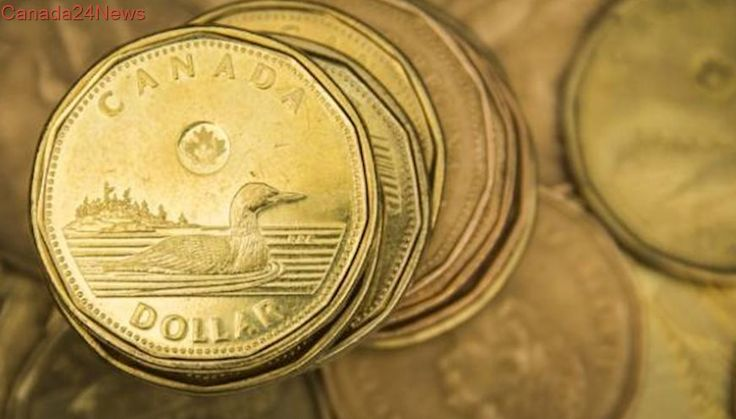 Canadian dollar soars, briefly touches 2-year high after rate hike