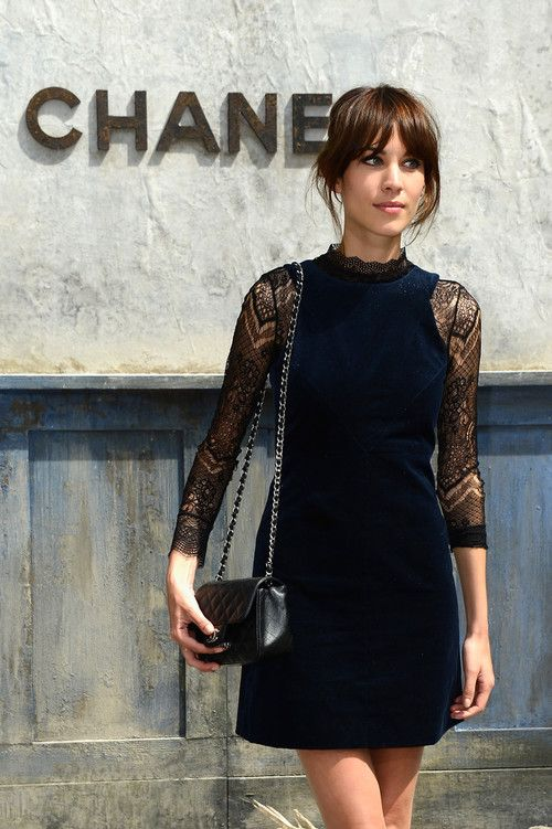 Alexa Chung. Black dress with lace sleeves.