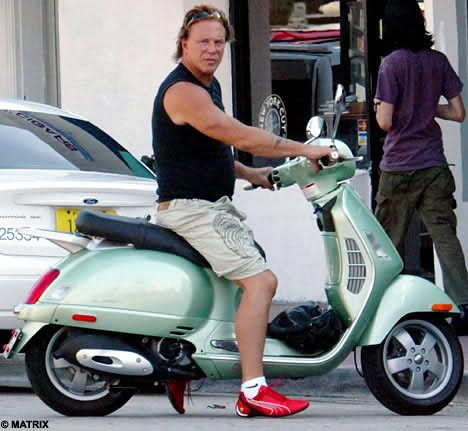 Man Riding Yamaha Vino