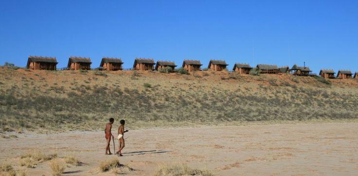 Two Bushmen walk in the Kalahari Desert