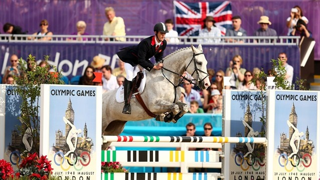 Nicholas Woodbridge of Great Britain riding Umberto de Fauquez competes in the Riding Show Jumping during the Men's Modern Pentathlon on Day 15.