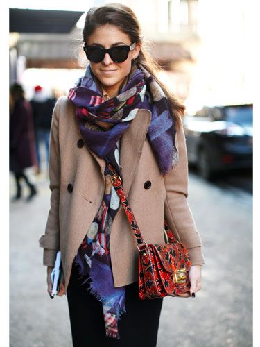 NYFW Fall 2014 street style :: Marianne Thompson - Coat: Jil Sander for UNIQLO Bag: Miu Miu Sunglasses: Celine Boots: Donna Karan