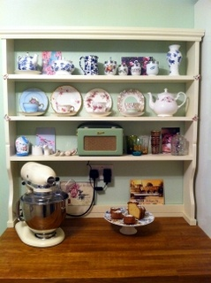 'Millie'   by www.meadow-made-vintage.co.uk  This shelving unit provides extra space at the bottom to house larger items (& avoid plugs!).