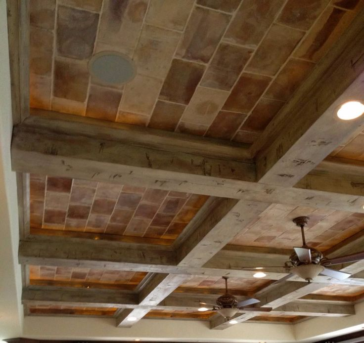 Ceiling using antique terra cotta brick and distressed wood beams