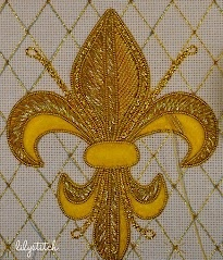 Gold embroidery over felt padding