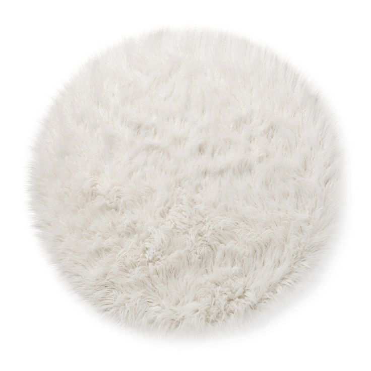 Create a favorite spot to sit in a child's room with the Faux Fur Rug (3' Round) White from Pillowfort. This round furry rug would also look elegant in a wardrobe in front of a full-length mirror.