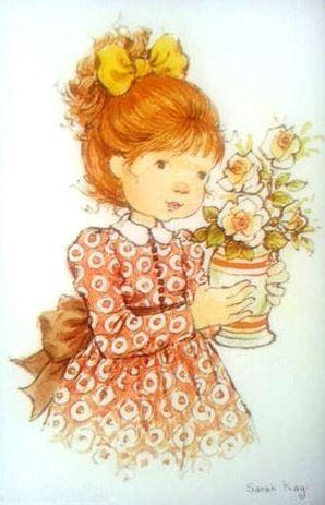 menina e vaso de flores.