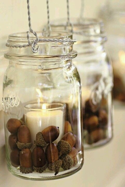 Fall decor - Mason jars with votive candle and acorns. Is it just me or would an autumn leaf or two just add to the perfection?