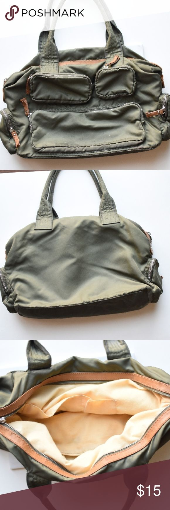 Gap Bag Gap bag that can be used for traveling, carrying your laptop, or as a gym bag. Beautiful bag with multi pockets. Signs of wear present inside the bag. gap Bags Travel Bags