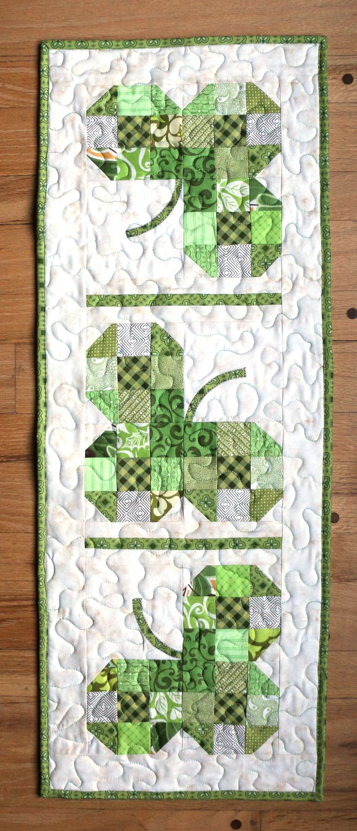 A St. Patrick's Day table runner made using the Quiltcut 2!  The ability to layer all my scraps before cutting made it SO easy!!!