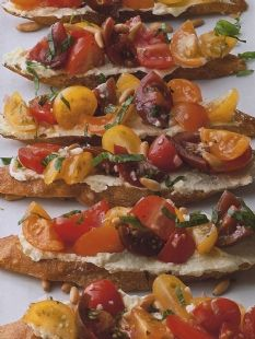 Barefoot Contessa - Recipes - Tomato Crostini with Whipped Feta...This is one of the best appetizers I have ever made. It is simple, full of flavor and beautiful to serve because of all the colors. 5 stars.