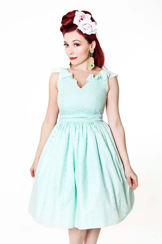 This is a stunning 50s inspired party dress, bringing you the colours and textures of nature in spring. It is perfect as a tea party dress, prom