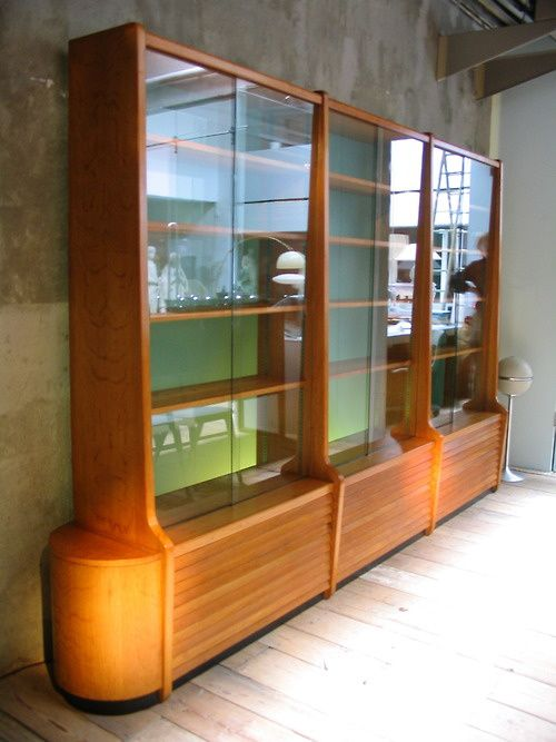 Gorgeous MCM Cabinet.  I need this to safely display my Stangl Amber Glo pottery!!