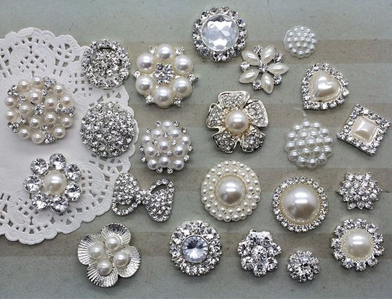These silver plated vintage inspired crystal embellishments are pave set with beautiful clear crystals and cream colored pearls. Perfect for many uses! it is the perfect compliment to your wedding gown, bridal sash, bridesmaid dress, wedding cake, bouquets, corsages, dress applique, napkin accessories, ring bearer pillow, bridal garter, bag, scarf, or updo. You can also add it to hair combs, shoe clips and even accent on home decor. 22 pieces/pack. ( 1 of each style as shown in photo) -...