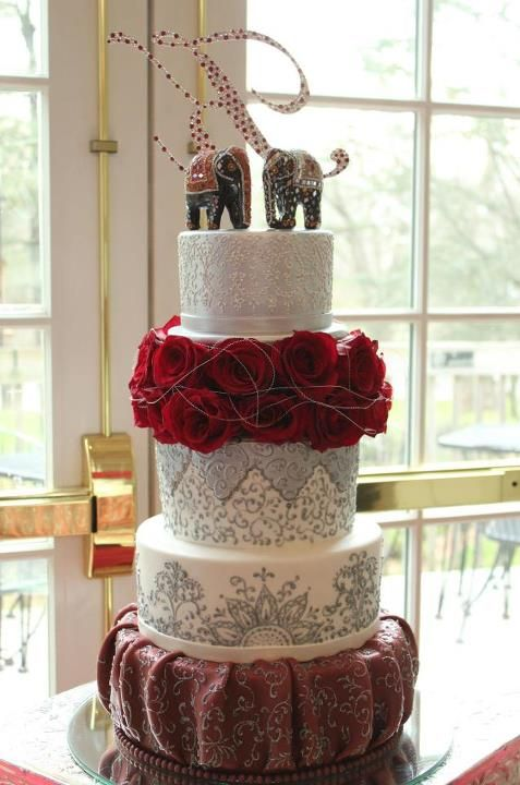 I LOVE THIS CAKE!!! My hubby would have loved this at our wedding. He collects Elephants and believes very deeply in their powers. Beautiful creatures on an amazing cake.