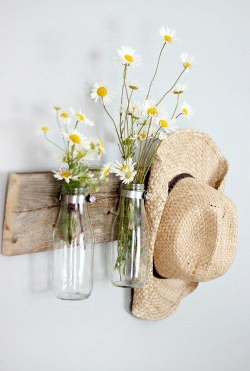 This fun Milk Bottle Floral Holder is perfect for bringing dimension to an empty corner in your home, while utilizing objects you may otherwise throw away!