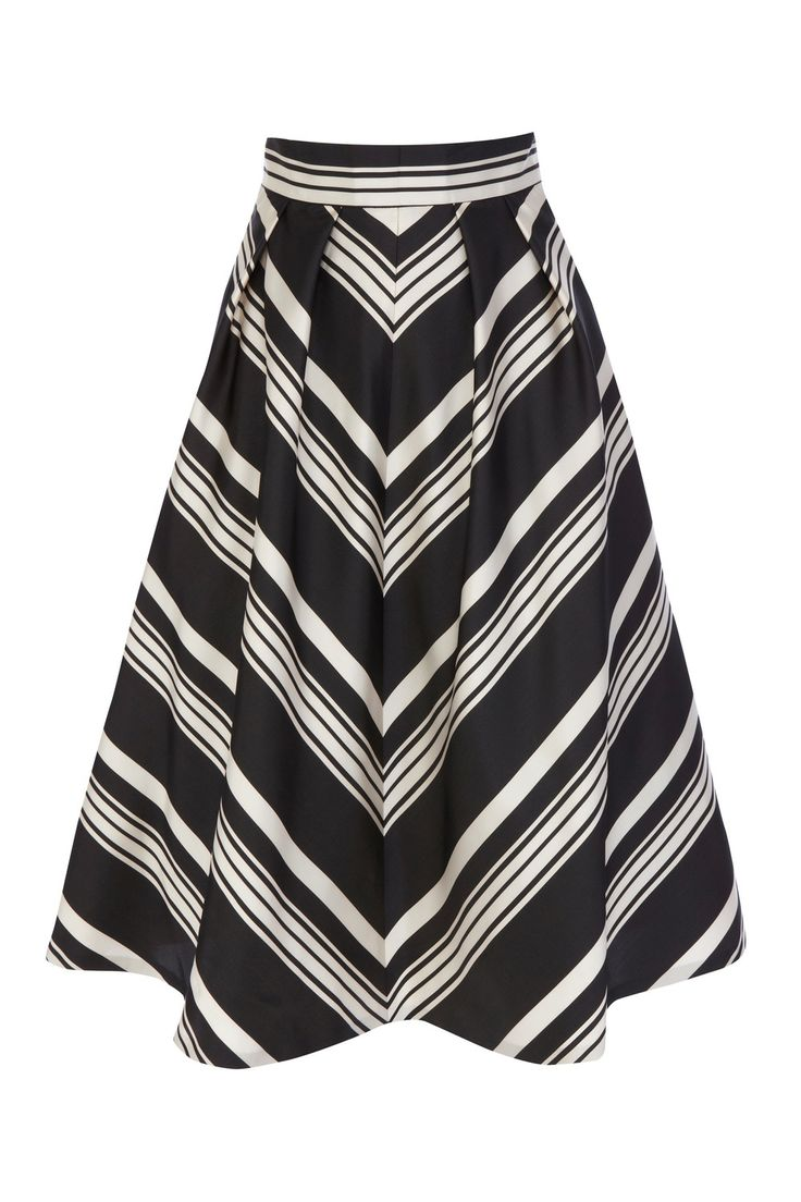 Get your transitional wardrobe ready with some key pieces for SS14 - The Mae Stripe Skirt is the perfect full statement skirt with graphic lines and large pleats creating a bold shape and vintage-inspired feminine silhouette. With modern details like large side seam pockets and the contemporary print, the balance with the traditional style and below-knee-length creates a unique combination. Wear with our Rasputin Cami Top for a balance and top off with some statement red lips.