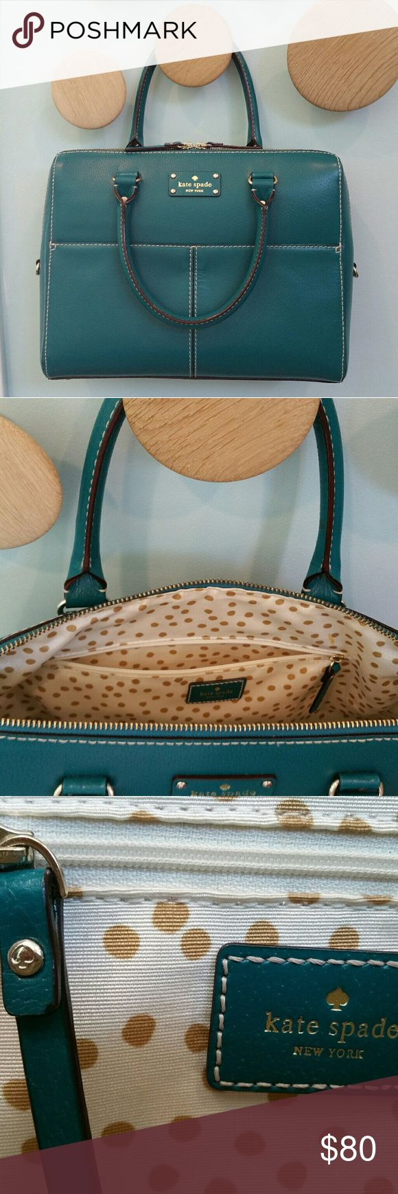 """Kate Spade Kingston Wellesley Leather Handbag Like-new teal leather KS handbag w gold polka dot lining and goldtone hardware with spade stamps. Leather pull zips on each side to meet in the middle,  or can zip one all the way over. Dual top handles,  approx. 5"""" drop. No exterior scratches, scuffs, flaws, etc. One stain in the interior above the zip pocket (see last pic). Inside has one zip pocket and two non-zip pockets for phone, etc. 13""""W x 10.5""""H x 5""""D (at bottomof bag; tapers to alost…"""