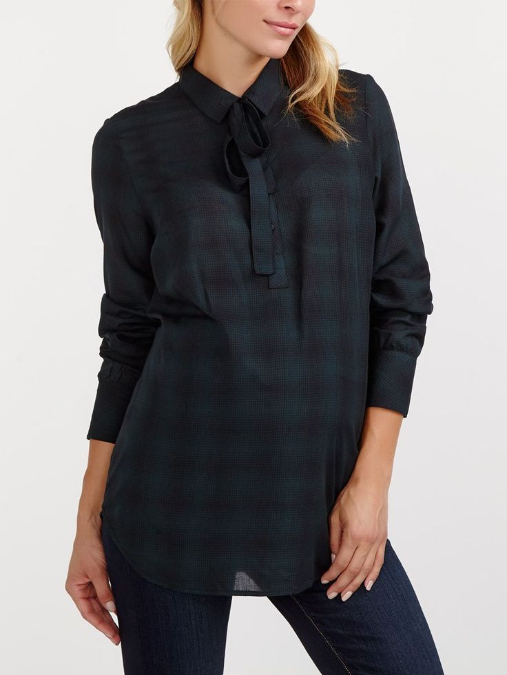 """We are loving plaid this season! Wear it proud with this gorgeous maternity blouse. Aside from the iconic pattern, it also has a shirt collar with buttons and a removable sash you can wear around your waist or tied as a bow at collar. A timeless piece you'll love throughout your pregnancy!<br /><br />- Length: 31 1/4"""" at front, 30"""" at back<br />- Soft challis fabric<br />- Can be worn during and after pregnancy"""